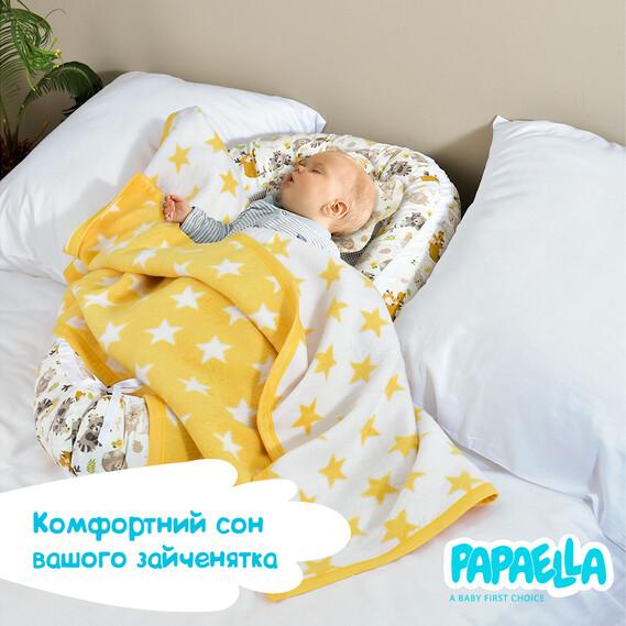 Младенец в текстильном гнезде