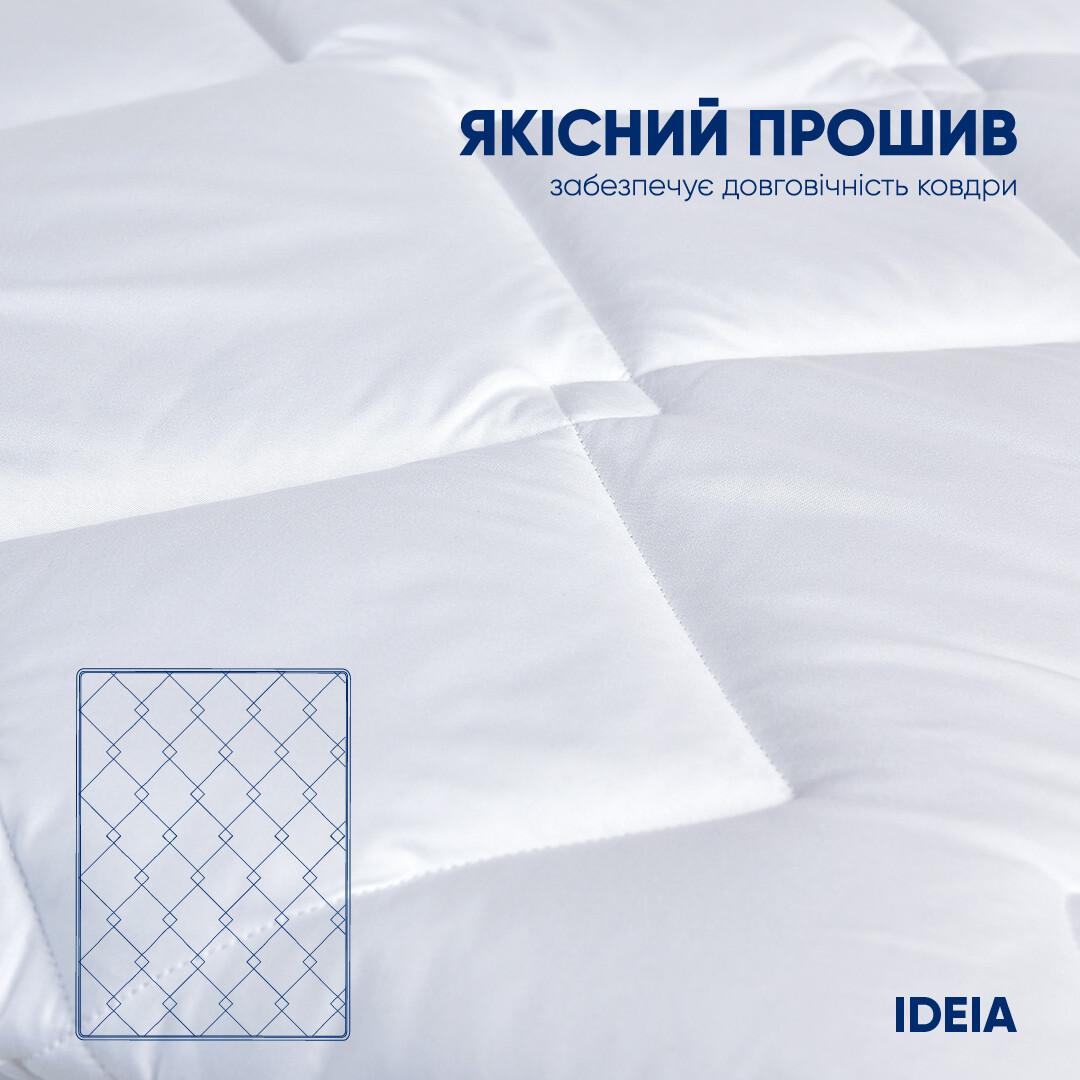 Качественно прошитое одеяло белое
